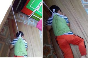 Bé trai bị buộc dây vào người, treo lên cửa sổ ở Nam Định khiến dư luận phẫn nộ
