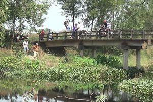 TP.HCM: Nghi án tài xế Grabbike bị sát hại, phi tang dưới chân cầu
