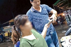 Bắt giam ba người liên quan vụ 'bảo kê' chợ Long Biên