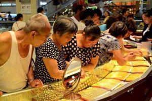 Giá vàng, bạc và bạch kim đều giảm trên thị trường châu Á