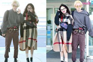 HyunA và E'Dawn tình tứ không rời tại sân bay, nhưng điều mà fan chú ý lại là quần của E'Dawn