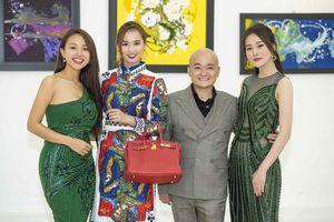 Dàn mỹ nhân chúc mừng NTK Cao Minh Tiến triển lãm tranh