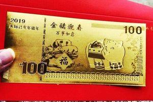 Tiền lì xì in hình heo gây sốt thị trường Tết