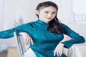 Dân mạng 'say mềm' với bộ ảnh hot girl Lào gốc Việt diện áo dài
