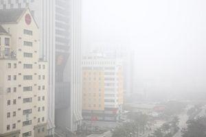 Chùm ảnh: Hà Nội đẹp mờ ảo trong sương mù