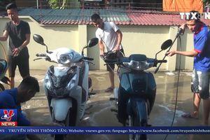 Rửa xe gây quỹ - giúp người hoạn nạn tại Nghệ An