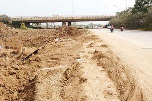 Những cái bẫy bùn đất và giao thông hỗn loạn trên Đại lộ Thăng Long