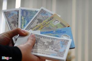 Thu phí đổi tiền mới, tiền lẻ có phạm pháp?
