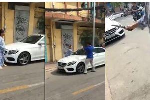 Người phụ nữ dùng búa đập phá xe Mercedes-Benz 2 tỷ đồng thoát kiện