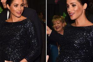 Meghan đeo vòng tay của Diana xem nhạc hội từ thiện