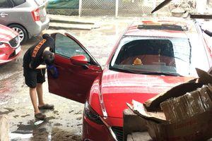 Chấp nhận làm việc đến chiều 30 tết, thợ rửa xe ô tô kiếm trung bình 4 triệu/ngày tiền công