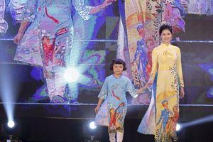Hoa khôi Miss Photo Vũ Hương Giang diện áo dài phản đối nạn bạo hành, xâm hại