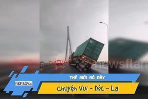 Gió mạnh xém quật ngã một xe container, đẩy ô tô xuống sông