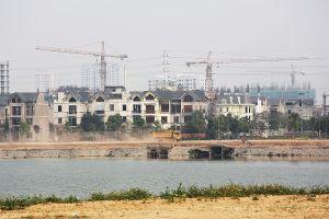 Kiểm soát chặt việc rót tín dụng bất động sản vào vùng sốt đất