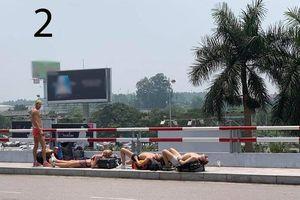 Nóng trên mạng xã hội: Khách Tây tắm nắng giữa trời 40 độ C ở Hà Nội