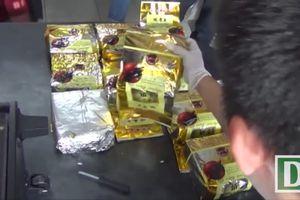 Cận cảnh công an khui 60 thùng loa chứa hơn 600kg ma túy