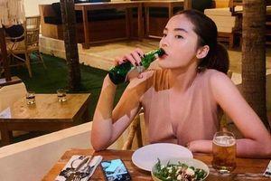 3 năm sau scandal hút thuốc lá gây chấn động, Kỳ Duyên khoe ảnh uống bia cả chai