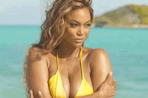Lên bìa tạp chí áo tắm ở tuổi 45, siêu mẫu Tyra Banks gây chú ý