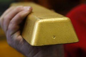Giá vàng lình xình, USD rớt mạnh