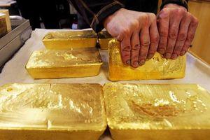 Giá vàng tăng 'chật vật' không vượt được 1.300USD/ounce