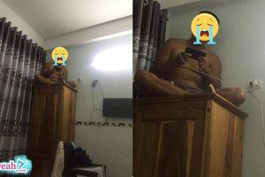 Chồng mê game bị vợ dọa cho lên nóc tủ ngồi, cuối cùng chị vợ phải nhún nhường dỗ mãi mới mới chịu xuống