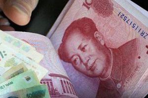 Nhân dân tệ mất giá gây áp lực lên tiền đồng Việt Nam?