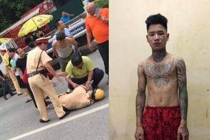 Hà Nội: Nam thanh niên xăm trổ lái xe máy 'thông chốt', tông gục trung úy CSGT