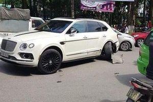 Sự thực về vụ siêu SUV Bentley Bentayga va chạm với taxi Nissan Grand Livina tại Hà Nội