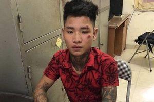 Hà Nội: Khởi tố nam thanh niên xăm trổ tông gục chiến sĩ CSGT giữa đường