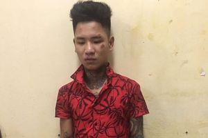 Thanh niên xăm trổ tông Trung úy CSGT trên QL32 bị khởi tố, bắt giam
