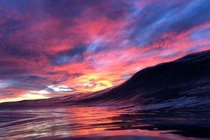 Khoảnh khắc bình minh 'ẩn mình' trong con sóng