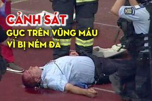 Cảnh sát gục trên vũng máu vì bị cổ động viên ném đá trúng đầu