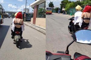 Nắng nóng 40 độ, cô gái tóc đỏ mặc áo lót ra đường khiến ai nấy sững sờ