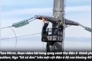 Hãi hùng khoảnh khắc thợ điện 'đu xà thể dục' trên cột điện cao thế