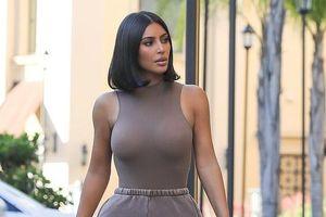 Kim Kardashian cắt tóc trẻ trung, phô đường cong 'bốc lửa' khi ra phố