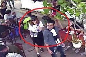 Cặp nam nữ thản nhiên bẻ hàng rào rồi vào quán cà phê 'bế hộ' chú chó của chủ quán