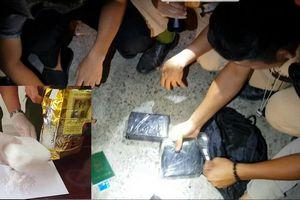 Bắt 2 kẻ xăm trổ lái ô tô vận chuyển ma túy từ Nghệ An ra Hà Nội