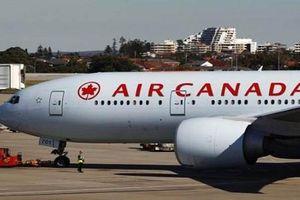 Máy bay Canada hạ cánh khẩn tại Mỹ, hàng chục người bị thương
