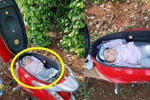 Đặt con vào cốp xe máy vì mẹ mải làm rẫy, hình ảnh khiến dân mạng tranh cãi gay gắt