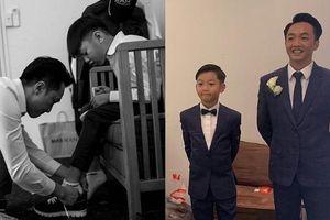 Cường Đô la chăm sóc bé Subeo trong lễ cưới