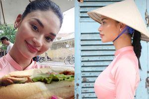 Hoa hậu Hoàn vũ Pia Wurtzbach mặc áo dài, đội nón lá ăn bánh mỳ ở Hội An