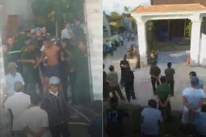 Giải cứu kẻ ôm bình gas cố thủ trong nhà ở Nghệ An