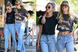 Miley Cyrus và bạn gái tin đồn vô tư khoác vai nhau dạo phố, vòng eo sexy của Miley nổi bật nhất khung hình