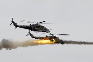 Trực thăng Nga tham chiến quyết giành lại thị trấn chiến lược ở Latakia