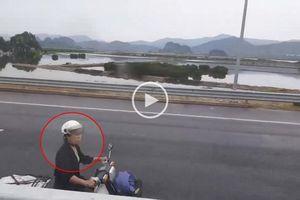 Clip: Người phụ nữ đi xe máy ngược chiều vào làn 100km/h trên cao tốc Hà Nội – Hạ Long