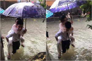 Bức ảnh chú rể cõng cô dâu trong trận lụt lịch sử ở Vinh bỗng dưng nổi tiếng