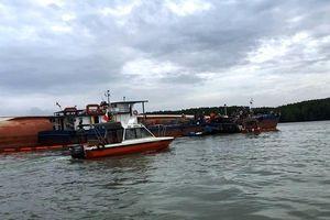 Bao giờ hút hết 150 tấn dầu trong tàu bị chìm ở Sài Gòn?