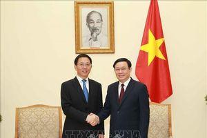 Phó Thủ tướng Vương Đình Huệ đề nghị Trung Quốc tháo gỡ khó khăn trong xuất khẩu nông sản