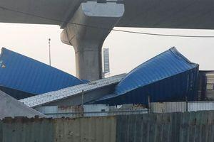 Xe container kéo sập dầm bê tông của công trình hầm chui xa lộ Hà Nội