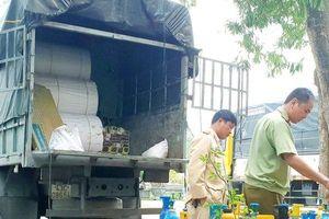 Thu giữ 100 bình nghi là khí cười trong xe tải